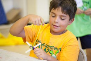 boy doing crafts and arts