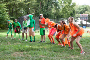 group of counselors in green and group of counselors in orange