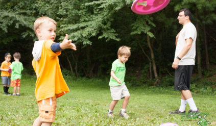 young boy throwing a frisbee