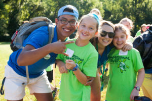 counselors and campers smiling at camera