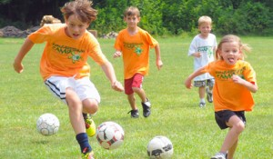 group of kids playing soccer