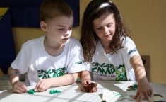 boy and girl learning geography at camp