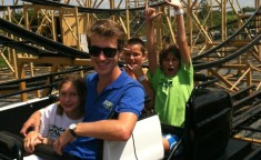 camp counselor and campers on roller coaster