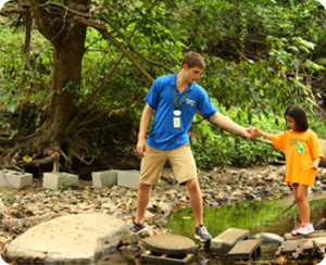 counselor helping a camper