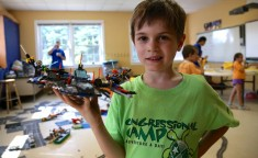 young boy holding Lego Star Wars ship