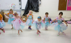 little girls dressed in tutu costumes