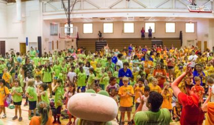 gymnasium full of campers and counselors