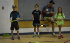 kids learning how to fly a drone