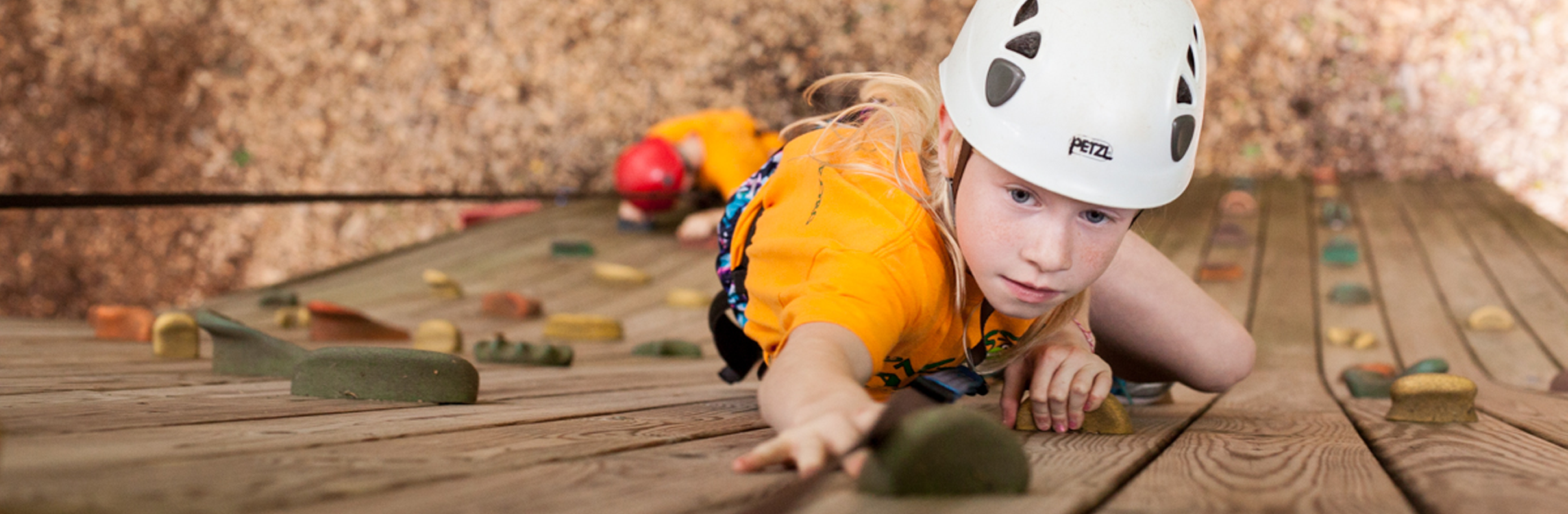 young camper rock climbing