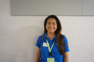 young woman with lanyard