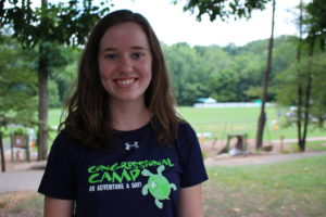 young woman smiling with congressional camp shirt