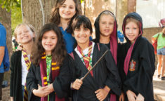 group of kids in harry potter robes