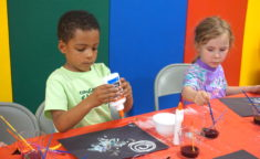 two young kids playing with arts and crafts