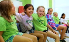 young girl campers smiling and bonding with each other